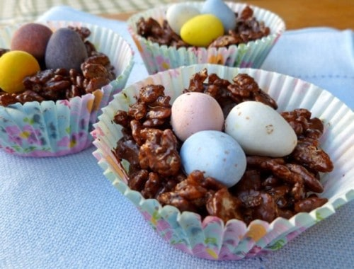 Chocolate Rice Krispie Easter Egg Nests with Cadbury mini eggs in paper cupcake cups.