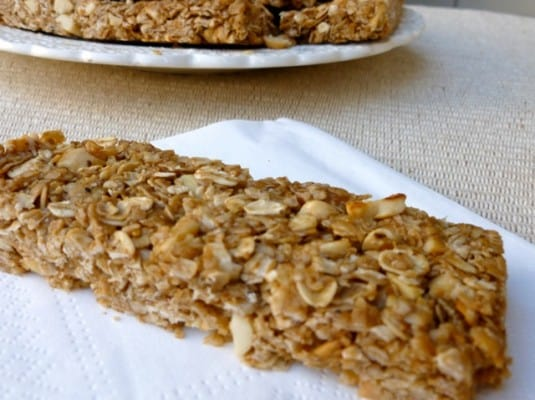 crunch peanut butter granola bar on white napkin foreground plate background