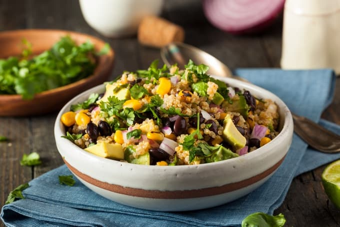Homemade Southwestern Mexican Quinoa Salad with Beans Corn and Cilantro in a white bowl