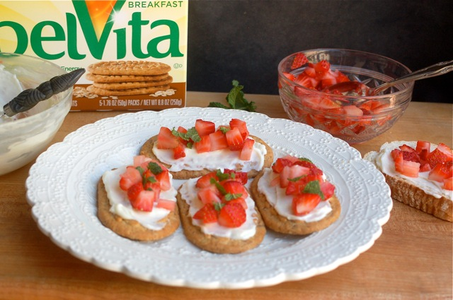 Plate of strawberry bruschetta with box of Belvita breakfast cookies in the background.