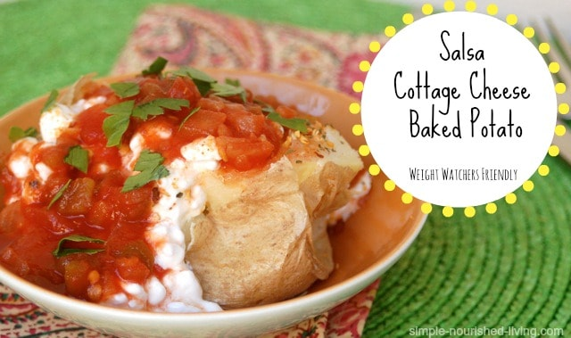 Salsa Cottage Cheese Baked Potato in orange bowl on a green placemat