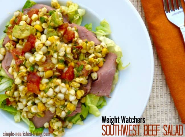 Southwestern Beef Salad with corn and chile lime dressing on white plate from above