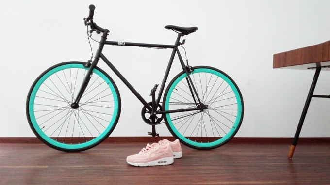 Bicycle and pink sneakers