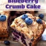 Blueberry crumb cake topped with fresh blueberries.
