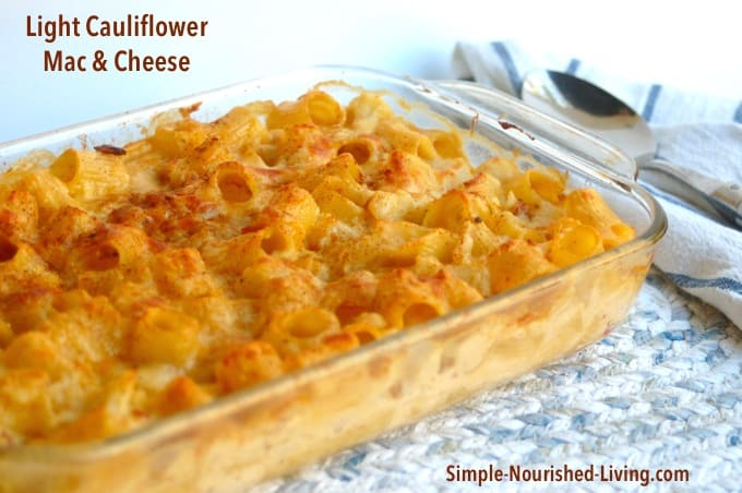 Macaroni and Cheese with Cauliflower in glass baking dish with serving spoon