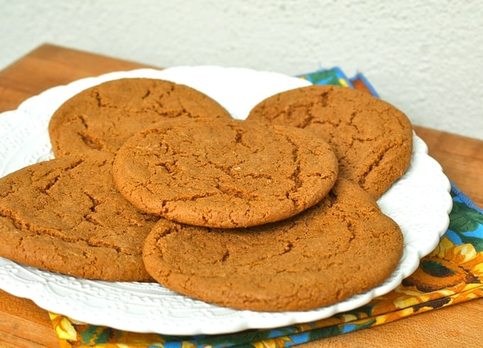 Five spice cookies on white plate.