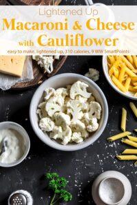 Chopped cauliflower in white bowl, dry penne pasta, cheese, bowl with Greek yogurt and sea salt on black slate for making Cauliflower Macaroni and Cheese.
