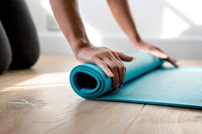 Urolling green yoga mat