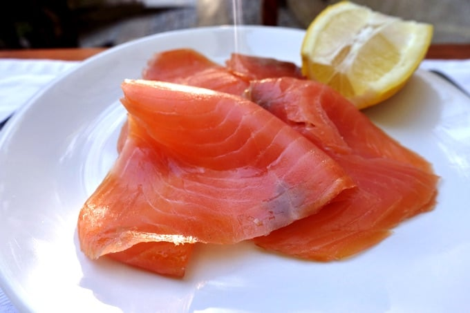 Smoked Salmon on small white plate with lemon