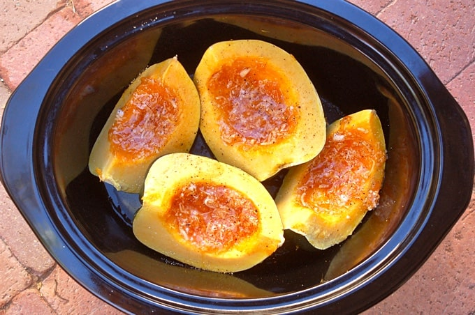 Slow Cooker Acorn Squash with Mango Chutney in crock pot.