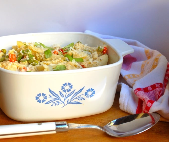 Pasta Primavera in a casserole dish with serving spoon