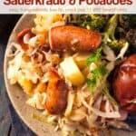 Kielbasa, sauerkraut and potatoes on dinner plate with broccoli and pretzel roll.