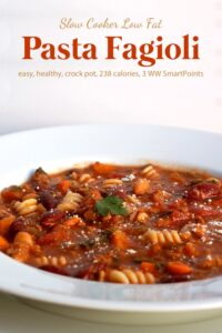 Low fat slow cooker pasta fagioli in white bowl up close.