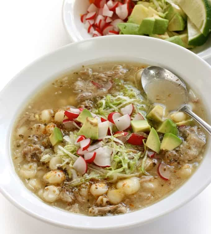 Chicken Posole Soup garnished with chopped radish and avocado