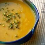 Slow Cooker Squash Apple Soup blue pottery bowl beige mat