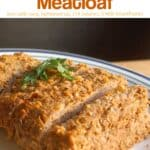 Slow cooker homestyle meatloaf garnished with fresh herbs on serving platter.