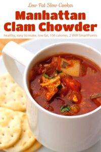 Manhattan clam chowder in a white mug with a plate of crackers.