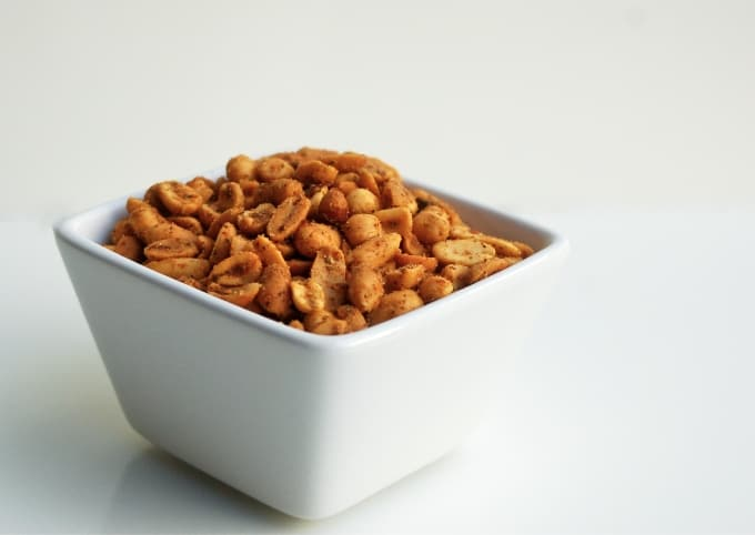 3-ingredient spicy peanuts in square white bowl.