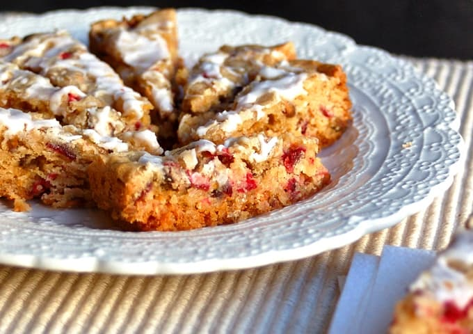 Cranberry White Chocolate Crock Pot Cookie Bars on white serving plate.