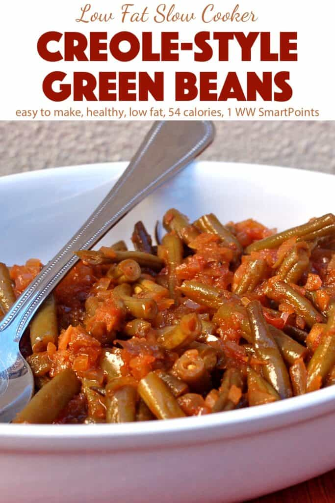 Creole-Style Slow Cooker Green Beans in white serving dish with spoon.