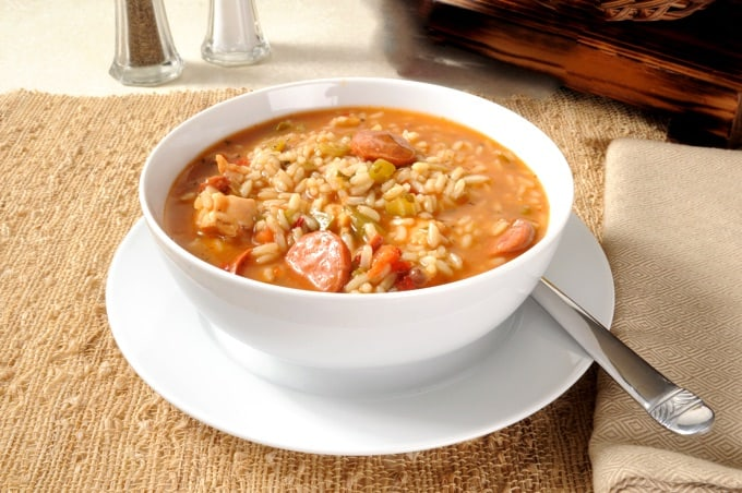 Sausage and chicken gumbo with rice in a white bowl