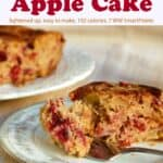 Slice of cranberry apple cake on plate with fork and rest of cake in the background.