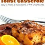 Slow cooker french toast casserole with bacon and orange slices on white plate up close.
