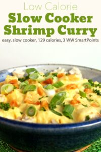 Bowl of low calorie shrimp curry topped with sliced green onions and peanuts
