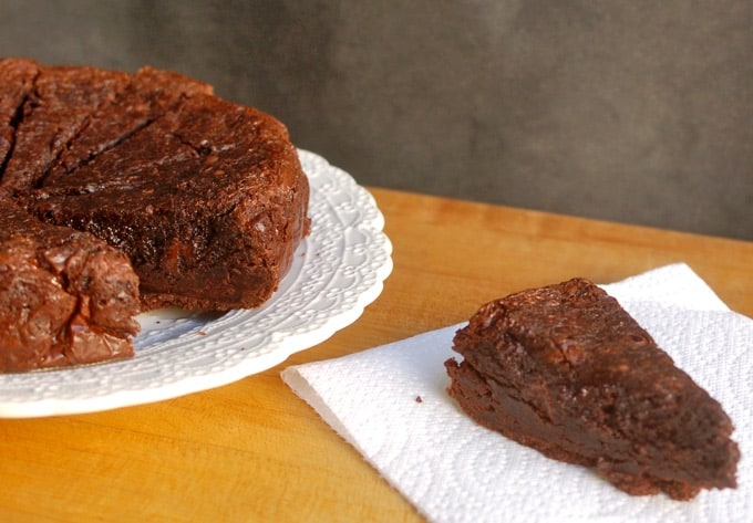Slow Cooker Triple Chocolate Brownies on a white serving plate