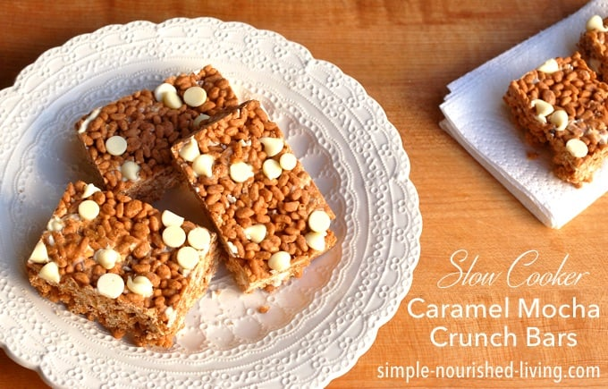 Caramel Mocha Crunch Cookie Bars with white chocolate chips on a white plate