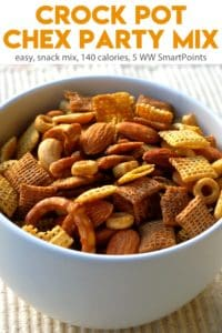 Slow cooker Chex party mix in white bowl.