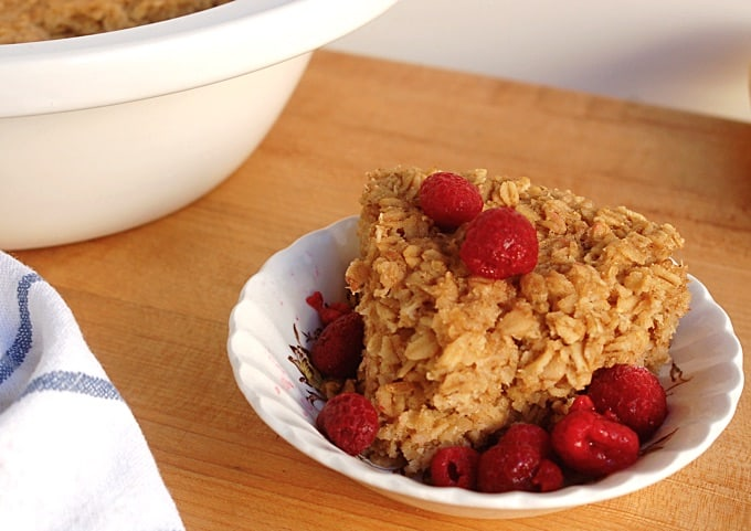 Crock Pot Baked Oatmeal in a bowl with fresh raspberries