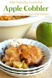 Crock pot apple cobbler in white bowl with green apple and crock pot in the background.