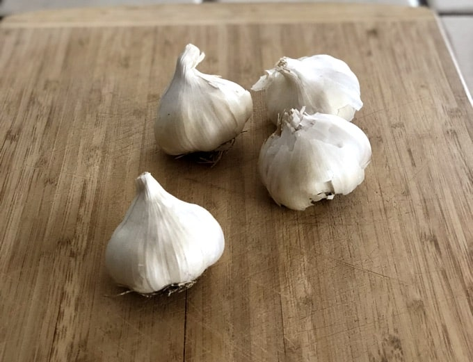 Fresh Garlic Bulbs on cutting board