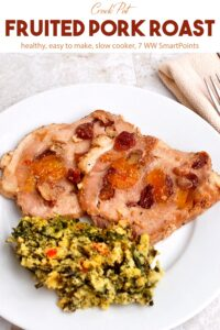 Fruited pork roast with spinach spoon bread on white dinner plate