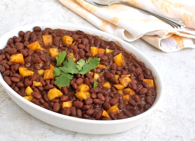 Caribbean Black Beans with Mango topped with fresh cilantro in a serving dish