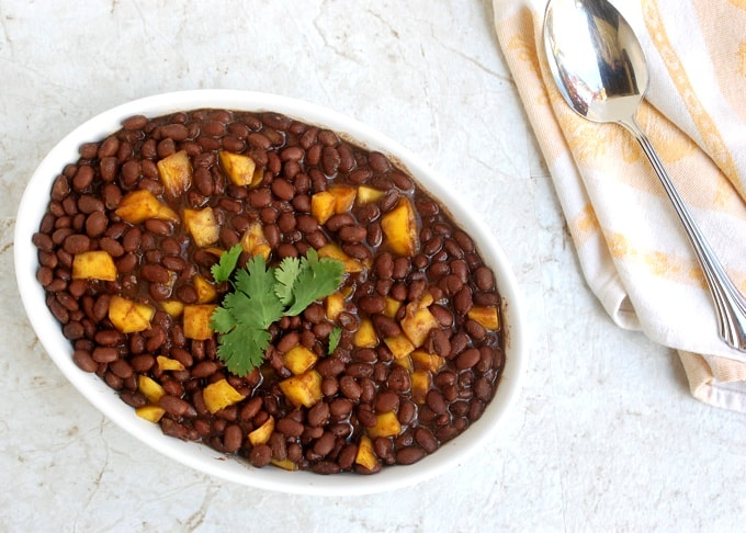 Caribbean Black Beans with Mango in a serving dish topped with cilantro from above