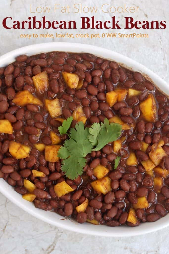 Caribbean Black Beans with Mango topped with fresh cilantro in a white serving dish