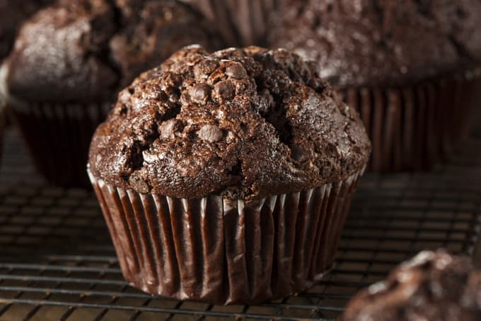 Homemade Dark Chocolate Bran Muffins on a cooling rack