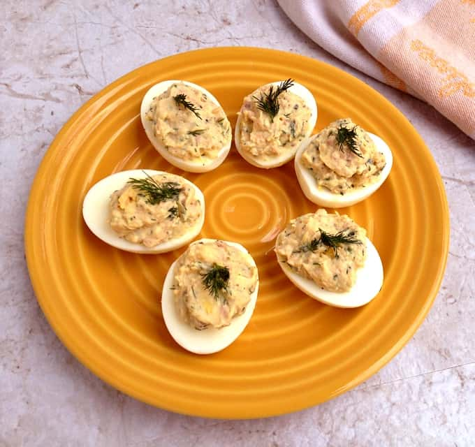 Salmon Deviled Eggs on orange plate