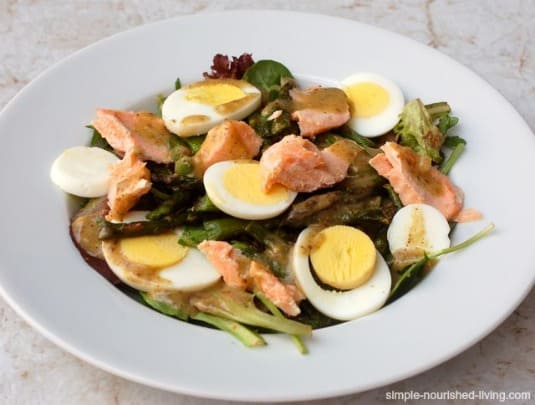 Salmon Hard Boiled Egg and Asparagus Salad in a white bowl
