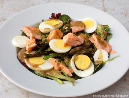 Salmon Egg Asparagus Salad in a white bordered bowl