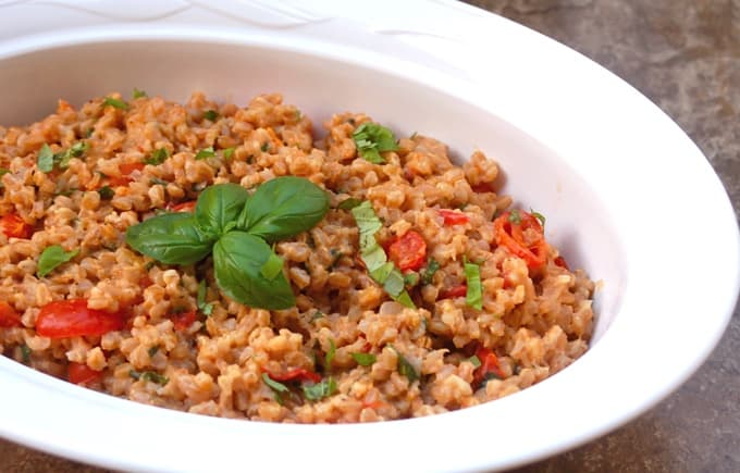 Farro with Cherry Tomatoes and Basil in white serving dish