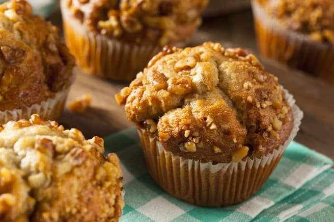 Homemade Apple Pecan Muffins on a green and white napkin