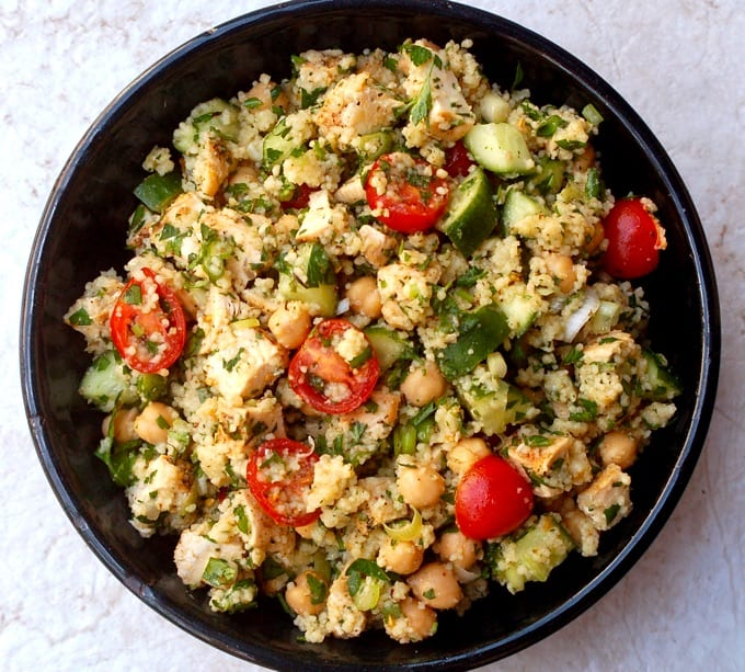 Mediterranean Chicken Couscous Salad with cucumber and tomatoes in a blue serving bowl