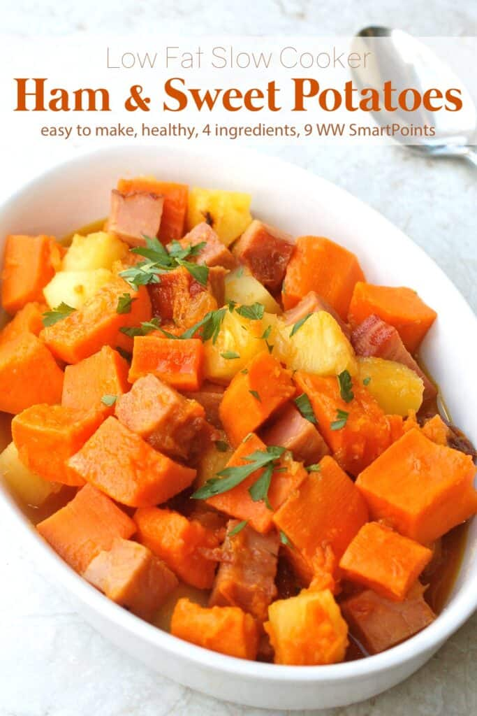 Cubed ham, sweet potatoes and pineapple in white casserole dish with serving spoon