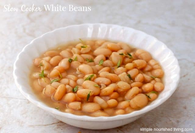 Slow Cooker White Beans with thyme in white bowl.