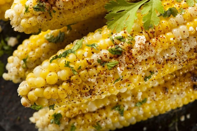 Corn on the cob with butter, chili powder and cilantro.