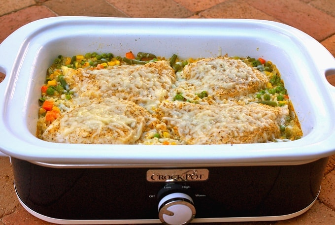 Casserole crock pot with cheesy chicken and rice casserole.