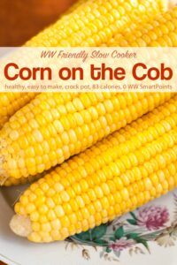 Three ears fresh cooked corn on the cob on serving platter.